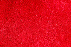 Vivid red textured leather skin background closeup Royalty Free Stock Image
