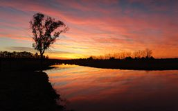 Vivid rural sunrise with fiery skies Stock Image