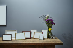 Vivid sideboard and picture frames Stock Photos
