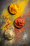 Vivid spices and herbs on old table Stock Photos