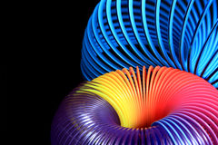 Vivid spirals on black. Bright and vivid colorful spirals on black background can signify imagination, technology, creativity, power stock photography