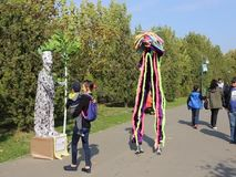Vivid statue and clown at LollyBoom Festival 2017 - family festival. Vivid statue and clown on stilts at LollyBoom Festival 2017  family festival in the Izvor stock video footage