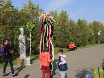 Vivid statue and clown at LollyBoom Festival 2017 - family festival. Vivid statue and clown on stilts at LollyBoom Festival 2017  family festival in the Izvor stock footage