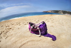 Vivid summer bags on the beach Royalty Free Stock Photography