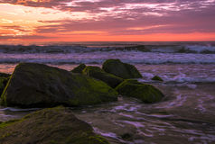 Vivid sunrise. Beautiful morning on the beach with dominated soft colors Stock Image