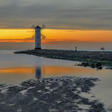 Vivid sunrise over pier and lighthouse in Swinoujscie, Poland. Royalty Free Stock Photo