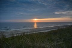 Vivid sunset at Dutch beach Stock Image