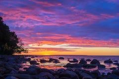 Vivid sunset over stony coast of Baltic sea Stock Image