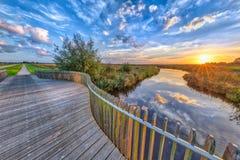 Vivid sunset over Wooden Balustrade Royalty Free Stock Image