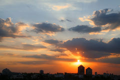 Vivid sunset/ sunrise colors in Gurgaon Haryana India. Silhouetted tower sunset in gurgaon india with birds going home royalty free stock photos