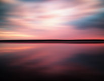 Vivid sunset sunrise horizon lake reflections landscape abstract Stock Images