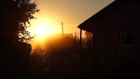 Vivid sunset in village stock footage