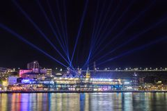 `Vivid Sydney`, festival, Sydney, Australia. Searchlights above `The Rocks`. The sky is filled with beams of light and colorful lighting illuminates the royalty free stock photography