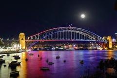 Vivid Sydney Harbour Bridge and City by night. NTH SYDNEY, AUSTRALIA - JUNE 6, 2015;  Scenic views across Lavender Bay, Sydney Harbour to  Sydney Harbour Bridge Royalty Free Stock Photo
