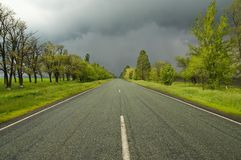 Vivid view with road and cloudy sky Stock Images