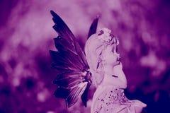 Vivid violet fairy. Creative fantasy art photo of a fairy on a vivid violet background Royalty Free Stock Photos