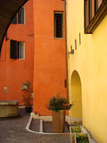 Vivid wall colors in Umbrian village. Luminous wall colors provide a sparkling background to an Umbrian village house in Italy royalty free stock photo