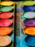 Vivid watercolor paint palette. Photo of a palette of watercolor paints on a well-used tray Royalty Free Stock Image