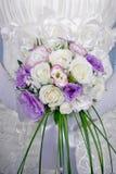 Vivid wedding bouquet at bride\'s hands. Close-up of  vivid wedding bouquet at bride\'s hands Stock Image