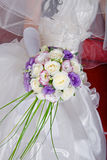 Vivid wedding bouquet at bride\'s hands Stock Photos
