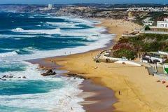 Vivid yellow sand and rocks on coastline, Portugal Stock Images