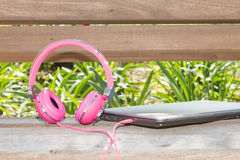 Vividl pink headphones and laptop Royalty Free Stock Photos