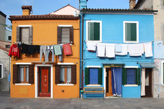 Vividly colored houses in Burano Venice Stock Photos
