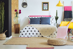 Vividly multicolored folk bedroom. Vividly multicolored bedroom with white wall in folk ethnic style Royalty Free Stock Photo