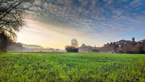 Viviers Cityscape in the Dawn morning Light. Viviers Cityscape in the atmospheric Dawn Light and dew drops on the meadow France Stock Image
