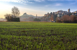 Viviers Cityscape in the Dawn morning Light. Viviers Cityscape in the atmospheric Dawn Light and dew drops on the meadow France Royalty Free Stock Photography