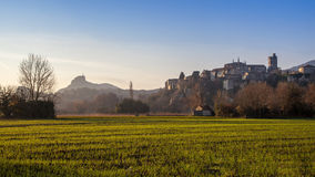 Viviers Cityscape in the Dawn morning Light. Viviers Cityscape in the atmospheric Dawn Light and dew drops on the meadow France Stock Photography