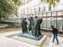 Visitor photographs the Burghers of Calais at the Rodin Museum, Royalty Free Stock Photography
