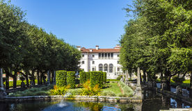 Vizcaya Museum and Garden in Miami, Florida. North Villa facade from the garden. Villa Vizcaya, now named the Vizcaya Museum and Gardens, is the former villa and Stock Photo