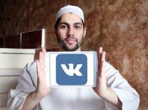 Vk logo. Vk application logo and vector on samsung tablet holded by arab muslim man Stock Image