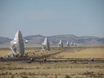 VLA antennas face east. Radio telescopes of the Very Large Array face the eastern horizon Royalty Free Stock Photo