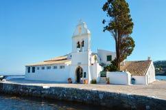 Vlacherna monastery on pontikonisi island in greece. Small ortodox monastery on corfu island in greece Stock Images