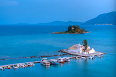 Vlacherna monastey at sunset. View of Pontikonisi area at Corfu island with sunset Royalty Free Stock Images