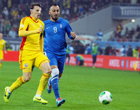 Vlad Chiriches and Konstantinos Mitroglou during FIFA World Cup Playoff Game Royalty Free Stock Images