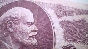 Vladimir Lenin-portret op de oude macro van het de roebelbankbiljet van Rusland, leider van Oktoberrevolutie 1917 stock footage