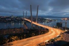 Vladivostok. Night view of the bridge in the Russian Vladivostok on the Golden Horn Stock Image