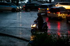 A Japanese moped stuck in a deep pool during the dark of the day during a typhoon royalty free stock photography