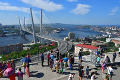 Vladivostok, Russia, August, 30,2018. Tourists looking for summer Vladivostok from the observation deck Eagle`s nest in sunnny day. Vladivostok, Russia. Tourists stock photo