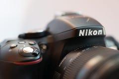 Nikon Camera Logo closeup. VLADIVOSTOK, RUSSIA - DECEMBER 4, 2017: Nikon Camera Logo closeup and Sigma lens. Nikon is a Japanese corporation headquartered in Stock Image
