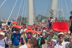 VLADIVOSTOK, RUSSIA - JULY 7: Flash-mob I love Vladivostok on the Golden Bridge. Stock Images