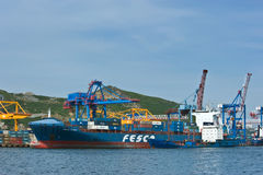 VLADIVOSTOK, RUSSIA - September 2, 2015: Bunkering tanker Ust-Karsk container ship FESCO Diomid in port Vladivostok. Royalty Free Stock Images