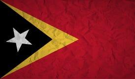 Vlag de Oost- van Timor met het effect van verfrommeld document en grunge royalty-vrije illustratie