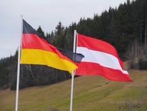 Vlag Duitsland Oostenrijk in openlucht Royalty-vrije Stock Afbeeldingen