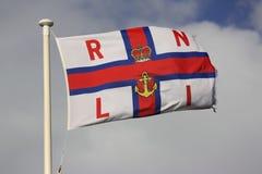 Vlag RLNI die op vlaggestok vliegt Royalty-vrije Stock Foto's