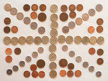 Vlag van aka Union Jack van het Verenigd Koninkrijk het UK met muntstukken wordt gemaakt dat Stock Fotografie