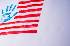 Vlag van de V.S., hand, op een witte achtergrond Stock Foto